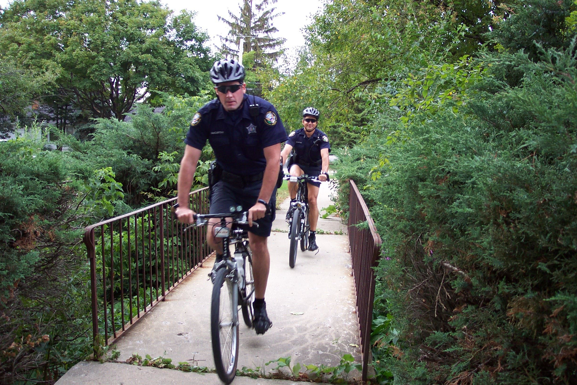 Image of two officers riding mountain bikes (PDF)