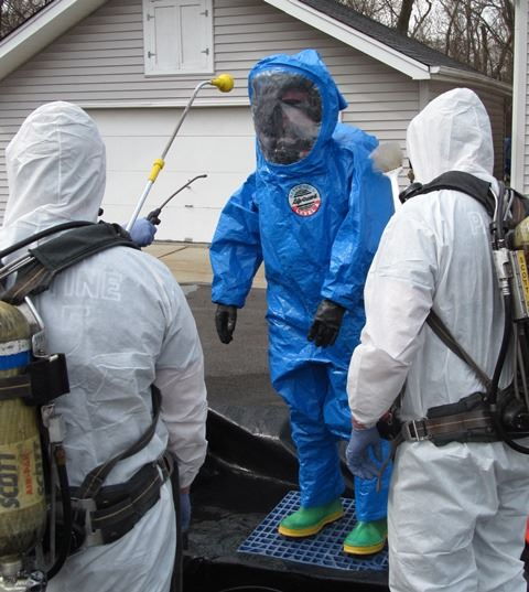 Hazardous Material Team in HazMat suits.
